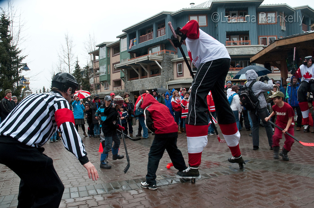 A comedy troupe, Duh Hockey Guys, entertain visitors to the 2010 Olympic Winter Games in Whistler, BC Canada