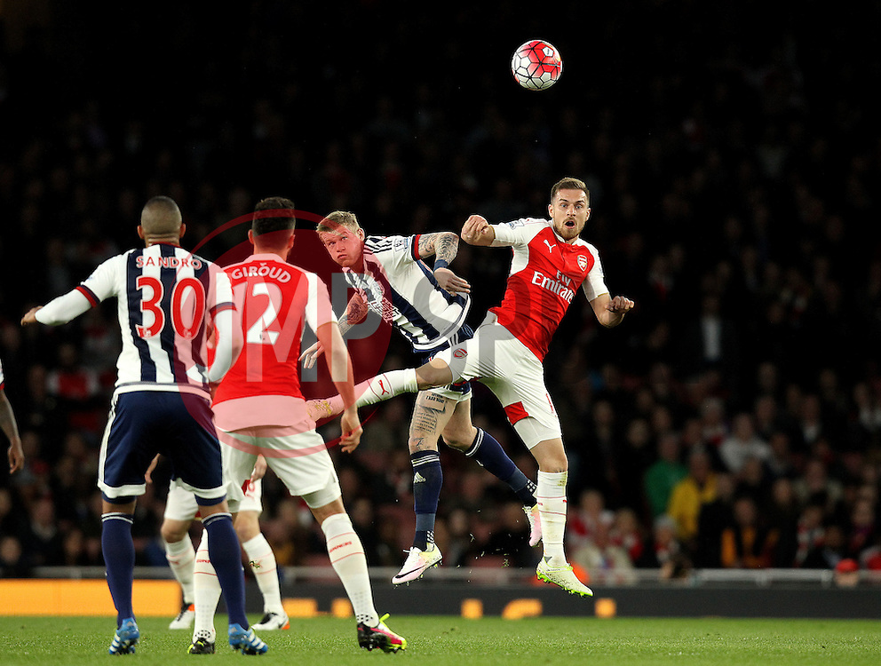 Aaron Ramsey of Arsenal battles for a header with Craig Dawson of West Bromwich Albion - Mandatory by-line: Robbie Stephenson/JMP - 21/04/2016 - FOOTBALL - Emirates Stadium - London, England - Arsenal v West Bromwich Albion - Barclays Premier League