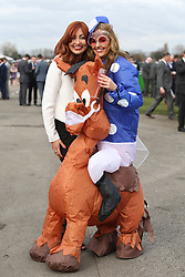 © Licensed to London News Pictures. 08/04/2016. Liverpool, UK. A woman dressed in a horse costume poses with her friend on Ladies Day at the Grand National 2016 at Aintree Racecourse near Liverpool. The race, which was first run in 1839, is the most valuable jump race in Europe. Photo credit : Ian Hinchliffe/LNP