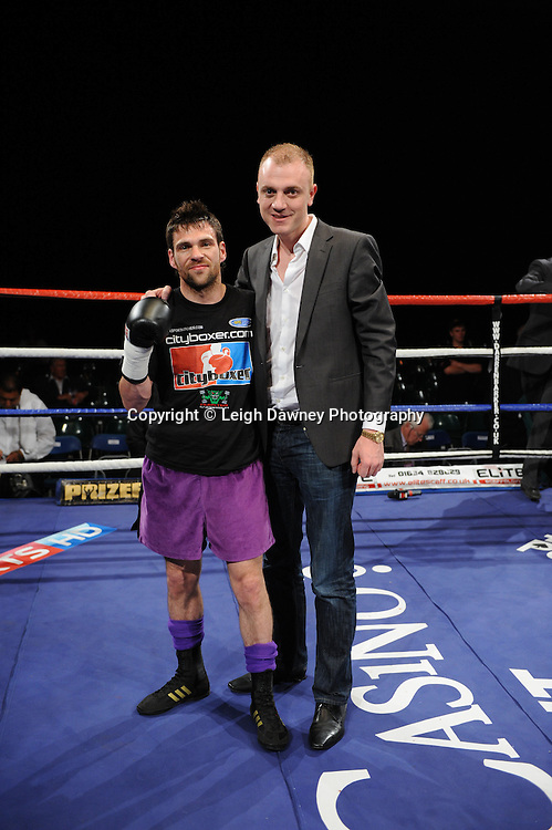 Phil Gill pictured with Manager Mickey Helliet after defeating Scott Evans at London's Olympia on Saturday 30th April 2011. Matchroom Sport. Photo credit © Leigh Dawney.