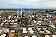 Nederland, Zuid-Holland, Rotterdam, 22-05-2011;.Botlek. De petrochemische industrie van olieraffinaderij Shell Pernis met olieopslag. Rechts in beeld de Eerste Petroleumhaven. Skyline Rotterdam. , links de Oude Maas..Botlek. The Petrochemical industry with oil storage. To the right  the Eerste Petroleumhaven (First Petroleum Harbour), the river Oude Maas (l).    . luchtfoto (toeslag), aerial photo (additional fee required).foto/photo Siebe Swart