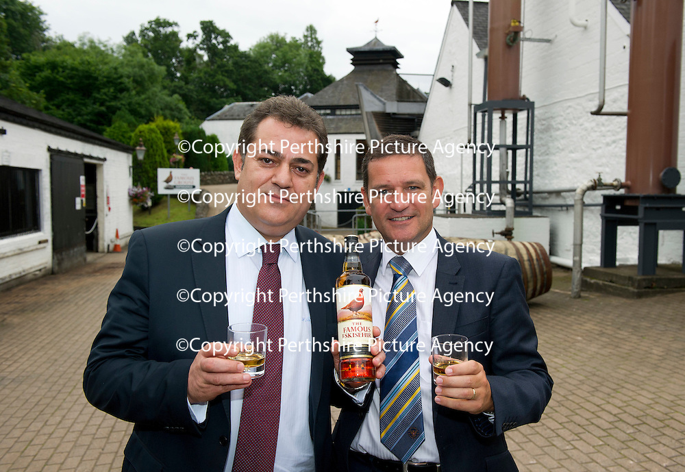 St Johnstone FC Chairman Steve Brown (right) presents a bottle of the specially labelled 'The Famous Eskieshir' whisky to Halil Unal President of Eskieshirspor who St Johnstone are playing in Uefa Cup Qualifyer. They are pictured at The Famous Grouse Experience in Crieff where the Turkish guests were given a guided tour ahead of tonight's match at McDiarmid Park....26.07.12<br /> Picture by Graeme Hart.<br /> Copyright Perthshire Picture Agency<br /> Tel: 01738 623350  Mobile: 07990 594431