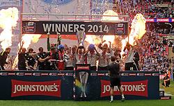 Peterborough United celebrate winning the Johnstone's Paint Trophy - Photo mandatory by-line: Joe Dent/JMP - Mobile: 07966 386802 30/03/2014 - SPORT - FOOTBALL - London - Wembley Stadium - Chesterfield United v Peterborough United - Johnstone Paint Trophy Final