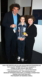 Actor JIM CARTER with his wife actress IMELDA STAUNTON and their daughter BESSIE CARTER at a reception in London on 20th January 2004.PPY 4