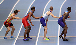 Athletes line up for the first baton change over during the Men's 4x400m round one race during day Three of the 2018 IAAF Indoor World Championships at The Arena Birmingham, Birmingham.