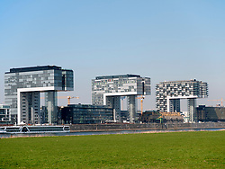 The new Kranhaus or Crane houses in the Rheinauhafen harbour area of Cologne, North Rhine-Westphalia, Germany