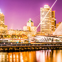 Milwaukee skyline at night panoramic picture in purple. Photo includes the Milwaukee lakefront, Milwaukee Art Museum, University Club Tower, and Northwestern Mutual Tower. Panoramic photo ratio is 1:3 and is high resolution.