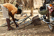 A boy pumps up his bicycle tyre at Tonga Junior High School.