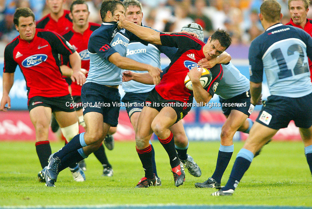 09/04/2005 Super 12 Bulls vs Crusaders at Loftus Pretoria Bulls won 35-20 - Daniel Carter gets tackled by Fourie du Preez and Morne Steyn