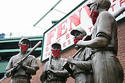 10/23/13 — BOSTON — The Teammates statue, featuring former Red Sox greats, from left, Ted Williams, Bobby Doerr, Jonny Pesky and Dom DiMaggio sport red beards in solidarity with the 2013 squad for the World Series at Fenway Park on Oct. 23, 2013.