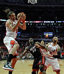 15.05.2011, UNITED CENTER, CHICAGO, USA, NBA, Chicago Bulls vs Miami Heat, im Bild Joakim Noah (L) goes to the basket against Miami Heat center Joel Anthony (C) in game 1 of the NBA Eastern Conference Championships at the United Center in Chicago, EXPA Pictures © 2011, PhotoCredit: EXPA/ Newspix/ KAMIL KRZACZYNSKI +++++ ATTENTION - FOR AUSTRIA/ AUT, SLOVENIA/ SLO, SERBIA/ SRB an CROATIA/ CRO, SWISS/ SUI and SWEDEN/ SWE CLIENT ONLY +++++