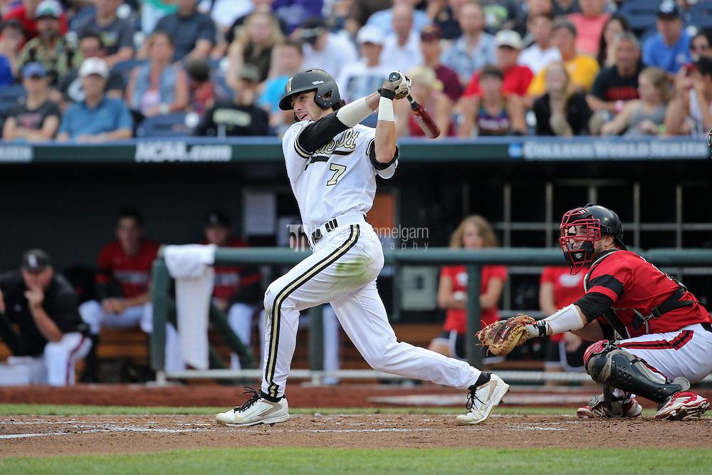 Dansby Swanson #7 of the Vanderbilt Commodores bats during Game 2 of the 2014 Men's College World Series between the Vanderbilt Commodores and Louisville Cardinals at TD Ameritrade Park on June 14, 2014 in Omaha, Nebraska. (Brace Hemmelgarn)