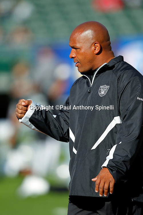 Oakland Raiders Offensive Coordinator Hue Jackson pumps his fist during pregame warmups during the NFL preseason week 3 football game against the San Francisco 49ers on Saturday, August 28, 2010 in Oakland, California. The 49ers won the game 28-24. (©Paul Anthony Spinelli)