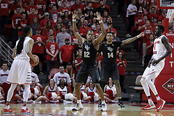 "20 March 2017:  Tony Wills(12) looks past Matt Williams and Nick Banyard to Daouda ""David"" Ndiaye (4) during a College NIT (National Invitational Tournament) 2nd round mens basketball game between the UCF (University of Central Florida) Knights and Illinois State Redbirds in  Redbird Arena, Normal IL"