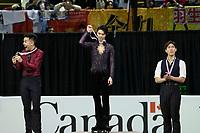 KELOWNA, BC - OCTOBER 27: Mens long program gold medalist, Japanese skater Yuzuru Hanyu (c), silver medalist, Canadian figure skater Nam Nguyen (l) and bronze medalist, Japanese skater Keiji Tanaka (r) stand on the podium at Prospera Place on October 27, 2019 in Kelowna, Canada. (Photo by Marissa Baecker/Shoot the Breeze)