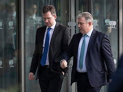© Licensed to London News Pictures. 10/12/2018. London, UK. Culture Secretary Jeremy Wright (L) and Tory Party Chairman Brandon Lewis leave a Conservative Friends of Israel event in central London. Prime Minister Theresa May is expected to call off tomorrows withdrawal agreement vote when she speaks in the House of Commons later. Photo credit: Peter Macdiarmid/LNP