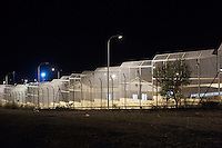 CALTANISSETTA, ITALY - 13 NOVEMBER 2014: External fence of the Pian del Lago CARA (Accommodation Centre for Asylum Seekers) in Caltanissetta, Italy, on November 13th 2014.<br /> <br /> To this date, the Pian de Lago CARA (Accommodation Centre for Asylum Seekers) hosts 491 asylum seekers, while 40 illegal immigrants are held in the CIE (Center for Identification and Deportation), before being deported.