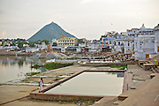 Ghats around Pushkar Lake, Rajasthan. <br /> <br /> Holy town of Pushkar, 14 kms from Ajmer is famous for its annual camel fair held in the autumn. With a scared lake, old temples and roof top restaurants, its a major tourist attraction attracting mostly foreign tourists. Pushkar also offers a great variety of delicious food. The town that got famous by its colorful camel fair is a very old religious place for Hindu pilgrims.