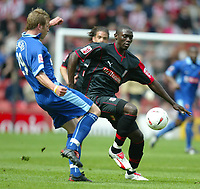 Photo: Chris Brunskill. Stoke City v Watford. Coca-Cola Championship. 30/04/2005. Kenwyne Jones of Stoke battles with Jay Demerit of Watford.