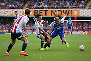Ipswich midfielder Teddy Bishop (7) battling for ball with Brentford defender Nico Yennaris (8)  during the EFL Sky Bet Championship match between Brentford and Ipswich Town at Griffin Park, London, England on 13 August 2016. Photo by Matthew Redman.