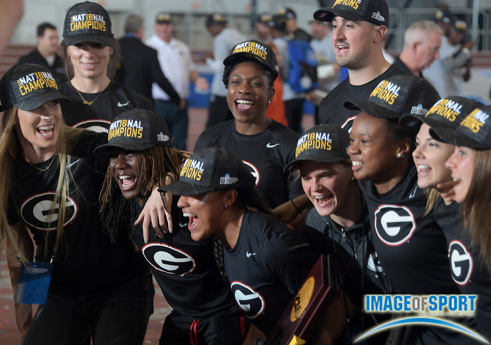 Mar 10, 2018; College Station, TX, USA; Members of the Georgia Bulldogs women's team and coach Petros Kyprianou celebrate after winning the team title during the NCAA Indoor Track and Field Championships at the McFerrin Athletic Center.