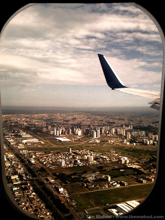 Final approach to Brasilia, Brazil, on the inaugural Delta flight from Atlanta to Brasilia.<br /> <br /> These are iPhone photographs from an iPhone 3G or iPhone 4. They were processed in various iPhone applications, such as Camera Bag or Plastic Bullet, then imported into Adobe Lightroom where they were enlarged and exported. When viewed at full size, there may be digital artifacts, &quot;noise,&quot; or decreased sharpness, as is the nature of the iPhone process.