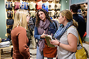 Guests mingle and look at clothing apparel and outdoor-outfitter gear during a grand opening event for Fjällräven Madison, a Swedish-heritage brand store in downtown Madison, Wis., on Oct. 22, 2015. Pictured at left is Victoria Albrecht, assistant manager of the Fjällräven Madison Store. (Photo by Jeff Miller - www.jeffmillerphotography.com)