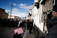 SYRIA - Al Qsair. A Syrian reporter as he is filming the funeral of a 14 y.o. boy shot to dead by a Regime Army sniper, on January 28,  2012. Al Qsair is a small town of 40000 inhabitants, located 25Km south-west of Homs. The town is besieged since the beginning of November and so far it counts 65 dead.In all Syria there are hundreds of non-professional reporters who without experience and without proper gear keep documenting, day after day, the crackdown of the regime. This series of pictures is dedicated to them... to this colleagues who among every kind of difficulties and risks let know to the word their stories and drama.  ALESSIO ROMENZI