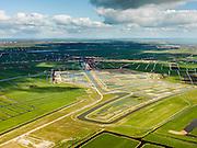 Nederland, Noord-Holland, Amsterdam (landelijk Noord), 16-04-2012; Waterland. Veenderij Zunderdorp en op het tweede plan de Volgermeerpolder. De polder maakte oorspronkelijk ook deel uit van de veenderij, tot in de jaren '50 is hier turf gewonnen. Na beeindiging van het vervenen werden de 'petgaten' volgestort met huisvuil en chemisch afval, onder andere met dioxine en benzeen afkomstig van Philips-Duphar..Inmiddels is de polder gesaneerd, de voormalige vuilstortplaats is afgedekt met folie en voorzien van en afdeklagen, bestaande uit zowel grond als ook water. Het ontwerp voorziet in een natuurgebied met 'sawa's' waarin nieuw veen zich kan ontwikkelen wat de vervuilde grond verder zal isoleren (natural capping)..The Volgermeerpolder in the rural area near Amsterdam once a landfill site for heavily polluted household and industrial waste, has been cleaned up using natural capping and turned into a nature area. .luchtfoto (toeslag), aerial photo (additional fee required);.copyright foto/photo Siebe Swart