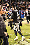Oakland Raiders quarterback Derek Carr (4) holds up his index finger signaling number one as he gets his first win during the NFL week 12 regular season football game against the Kansas City Chiefs on Thursday, Nov. 20, 2014 in Oakland, Calif. The Raiders won their first game of the season 24-20. ©Paul Anthony Spinelli