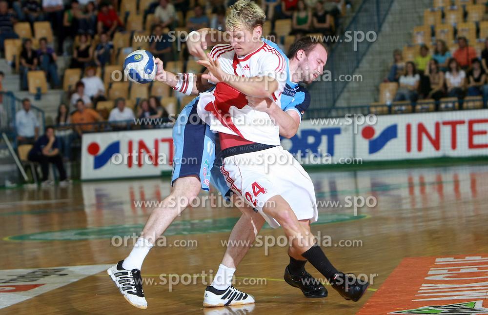 Martin Stranovsky of Slovakia vs Vid Kavticnik of Slovenia at  handball game between men national teams of Slovenia and Slovakia, first qualification game for the World Chamionship 2009, on June 7, 2008, in Arena Zlatorog, Celje, Slovenija. Result: 33 : 33. (Photo by Vid Ponikvar / Sportal Images)