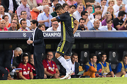Sami Khedira of Juventus FC (M) leaves the match injured during the UEFA Champions League group H match between Valencia FC and Juventus FC at Estadi de Mestalla on September 19, 2018 in Valencia, Spain