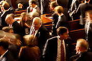 Republican congressmen and their families mingle prior to being sworn in to office at the United States Capital in Washington, DC on Wednesday, January 5, 2011.
