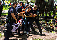 Christopher Rey Monzon, 22,  gets ambush by police and then arrested and charged with disorderly conduct, aggravated assault and inciting a riot after he crossed through police tape to confront the anti-hate symbol gathering outside the Hollywood's City Hall on Wednesday August 30, 2017. <br /> <br /> photo by Samuel Navarro.