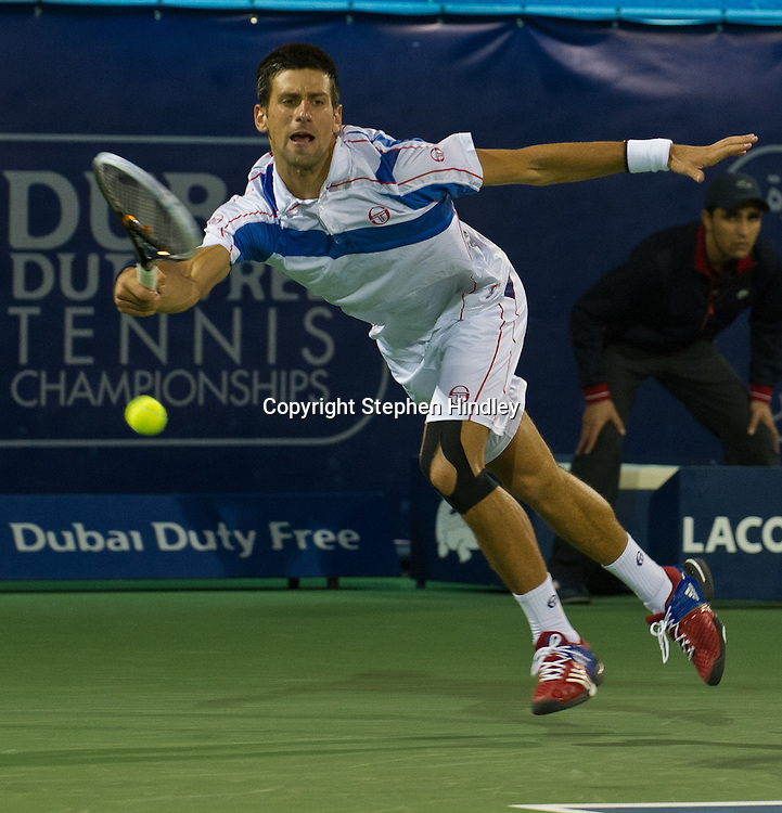 Novak Djokovic of Serbia plays a return shot to Feliciano Lopez of Spain during the second round of the Dubai Duty Free Tennis Championships, held at the Dubai Tennis Stadium in Dubai, UAE, Wednesday, February 23rd, 2011. Photo by: Stephen Hindley/SPORTDXB