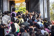 """VARKALA, INDIA - 21st September 2019 - Pilgrims and Hindu holy men perform a puja prayer ritual for Sree Narayana Guru during his memorial day at the Sivagiri Mutt pilgrimage centre. Sree Narayana Guru was a spiritual leader who led a reform movement against the injustice of the caste system in India. He promoted the term """"One Caste, One Religion, One God for All."""" The Sivagiri Mutt is the believed site of the guru's enlightenment and is now home to the headquarters of the Sree Narayana Dharma Sangham - an organisation built by his disciples and followers. Kerala, Southern India."""