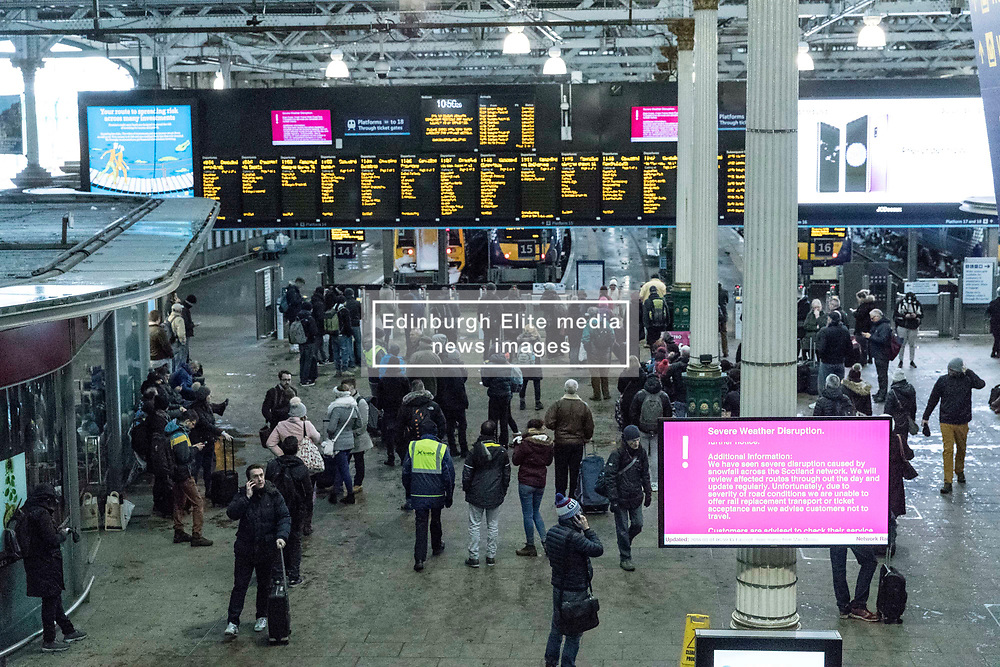 The Beast from the East, Storm Emma hit Edinburgh overnight and has left transport links decimated and many of the shops on the famous Princes Street closed for the day.<br /> <br /> Pictured: Commuters are left stranded in Edinburgh's Waverley Station as all trains out of the city are cancelled.