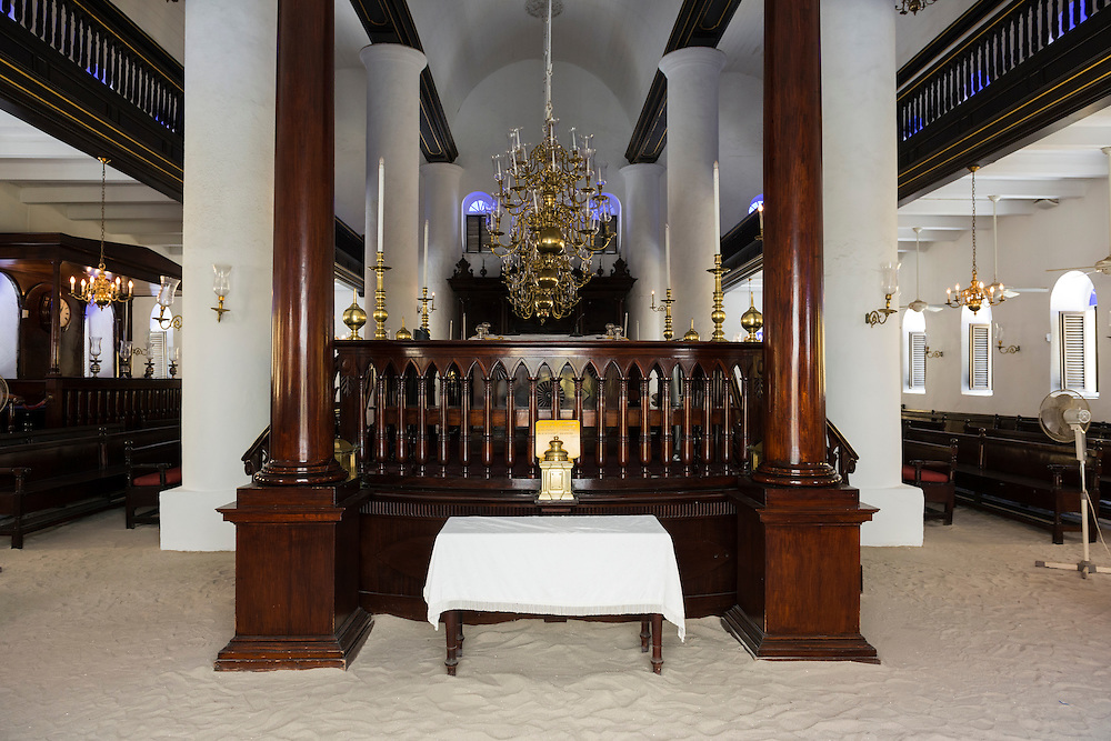 Interior of the Mikve Israel-Emanuel Synagogue in Willemstad, Curacao. The synagogue is the oldest in continuous use in the western hemisphere. Jews moved to Curacao in the 1650s; the current building dates from 1730. The sand floor is said to symbolize one of three things:<br />