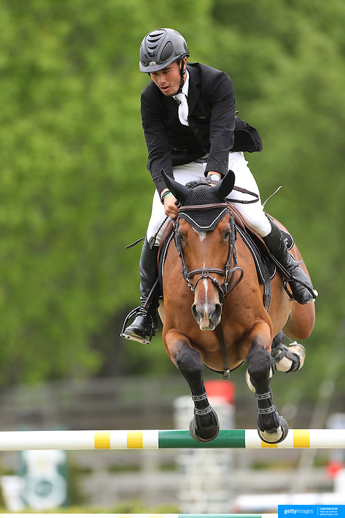 NORTH SALEM, NEW YORK - May 21: Juan Salgado riding Coptic II RV in action during The $15,000 Under 25 T & R Development Grand Prix at the Old Salem Farm Spring Horse Show on May 21, 2016 in North Salem, New York. (Photo by Tim Clayton/Corbis via Getty Images)