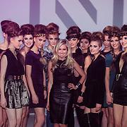 NLD/Amsterdam/20130205 - Modeshow Nikki Plessen 2013, Nikkie Plessen tussen haar mannequins
