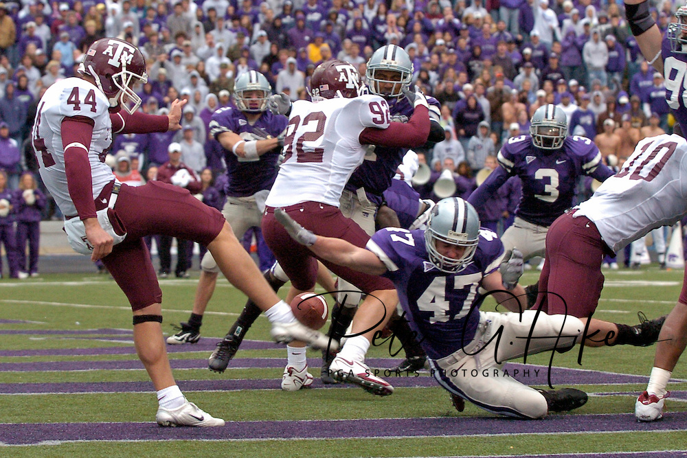 Texas A&M punter Justin Brantly (44) has his punt blocked by Kansas State's Adam Hamilton (47), resulting in a Wildcat touchdown during the fourth quarter at KSU Stadium in Manhattan, Kansas, October 22, 2005.  Texas A&M beat Kansas State 30-28.
