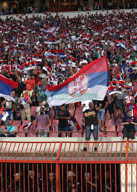 Police on duty underneath Serbia fans in the stands during the 2018 FIFA World Cup Qualifying, Group D match at the Rajko Mitic Stadium, Belgrade.