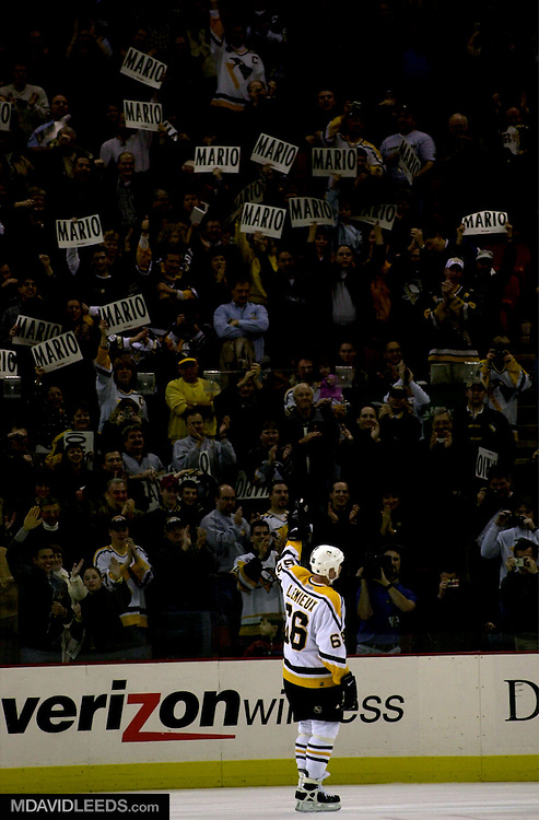 27 Dec 2000:  Mario Lemieux #66 of the Pittsburgh Penguins waves to the crowd before leaving the ice following the game between the Toronto Maple Leafs and the Pittsburgh Penguins at the Mellon Arena in Pittsburgh, Pennsylvania. The game was the first in which Lemieux has played since retiring three season's ago. The Penguins won the game 5-0. DIGITAL IMAGE Mandatory Credit: M David Leeds/ALLSPORT