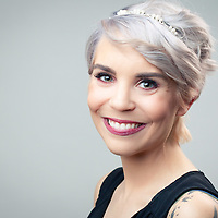 Beautiful headshot with short hair and tattoos, gray background, headshot photography, commercial photography, Tucson
