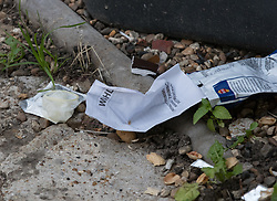 © Licensed to London News Pictures. 21/09/2017. London, UK. A condom and other rubbish is seen in the front garden of a property in Thornton Heath, south London where a 17 year old was arrested last night. This is the sixth arrest in connection with the bombing of an underground train at Parsons Green on September 15th. The bomb failed to fully explode but still injured 30 people. Photo credit: Peter Macdiarmid/LNP