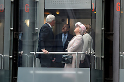 The queen and Duke ride a lift at Lloyds of London to the top floor for lunch.<br /> HM The Queen and the Duke of Edinburgh visit  Lloyd's of London, in the City of London, United Kingdom. Thursday, 27th March 2014. Picture by Ben Stevens / i-Images