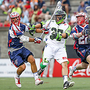 Jerry Ragonese #37 of the New York Lizards looses his stick while Craig Bunker #22 of the Boston Cannons and Matt Smalley #11 of the Boston Cannons surround him during the game at Harvard Stadium on July 19, 2014 in Boston, Massachusetts. (Photo by Elan Kawesch)