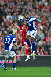 LIVERPOOL, ENGLAND - Saturday, April 23, 2011: Liverpool's Lucas Leiva and Birmingham City's Cameron Jerome during the Premiership match at Anfield. (Photo by David Rawcliffe/Propaganda)