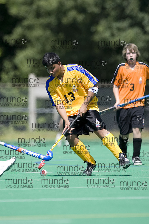 (Ottawa, Ontario---13 August 2008) The Central Region (Yellow) plays the West Region (Orange) in boys field hockey at the 2008 Ontario Summer Games in Ottawa. Photo copyright Sean Burges/Mundo Sport Images. More details can be found at www.msievents.com.