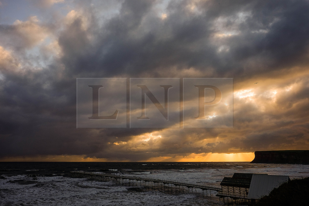 © Licensed to London News Pictures. 24/04/16<br /> Saltburn by the Sea, UK. <br /> <br /> Storm clouds can be seen off the coast at Saltburn by the Sea. Temperatures dropped over the weekend as cold air blew down from the arctic.  <br /> <br /> Photo credit : Ian Forsyth/LNP